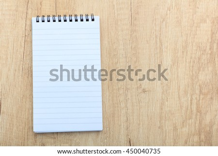 Open notepad on a wooden surface