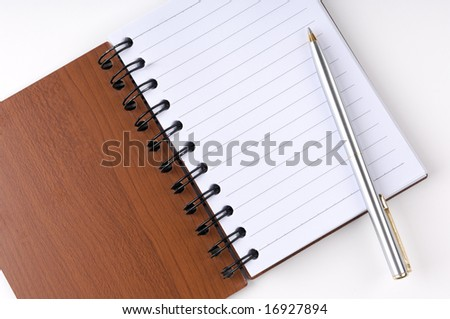 Open notepad with a pen - stock photo
