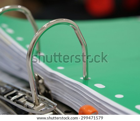 Open of file document, inside has green plastic sheet placed on top.