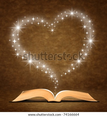 open old book. a star, heart graphic at the top of the book. - stock photo