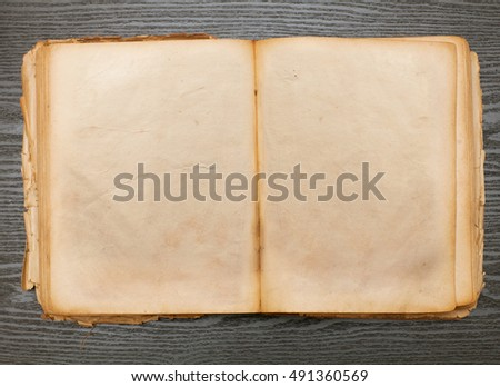 open old book for recording on a wooden table