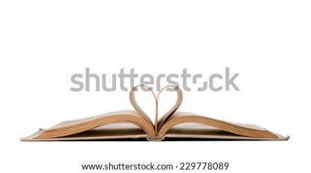 open old book forming a heart isolated on white - stock photo