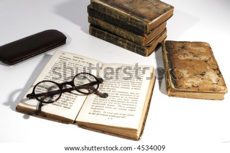 Open old book from 1800 with old spectacles