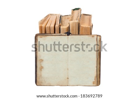 open old book on a pile of books isolated on white - stock photo