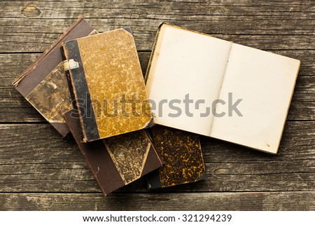 open old book on old wooden table - stock photo