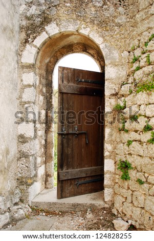 Open old door in the castle - stock photo