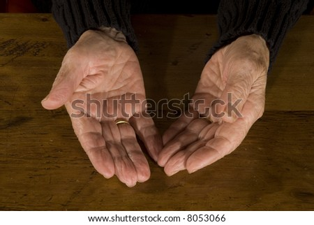 open old hands with wedding-ring