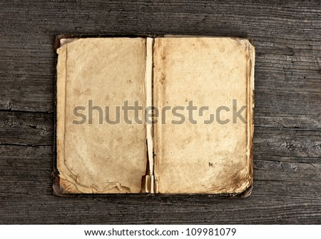 open old vintage book on grungy wooden background - stock photo
