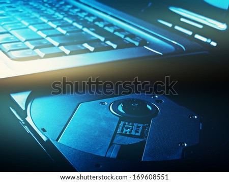 Open optical disc drive on a notebook  - stock photo