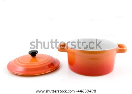 Open orange casserole isolated on white background - stock photo
