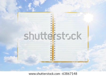 Open Orange notebook and sun sky for text and background - stock photo