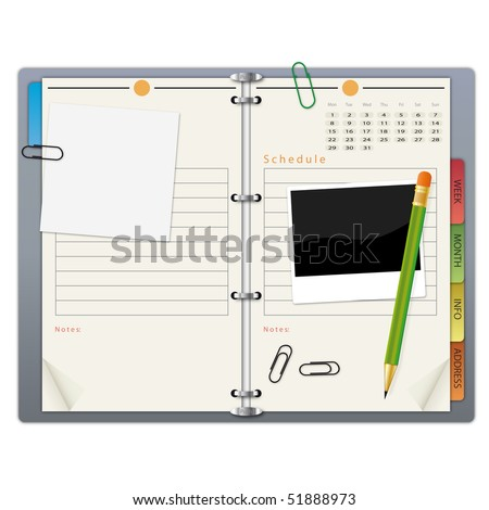 Open organizer with a green pencil  and paper clips.
