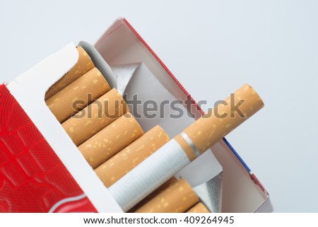 Open pack of cigarettes isolated - stock photo