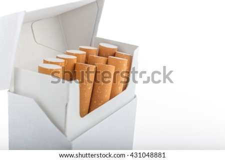 Open pack of cigarettes stands vertically over white background - stock photo