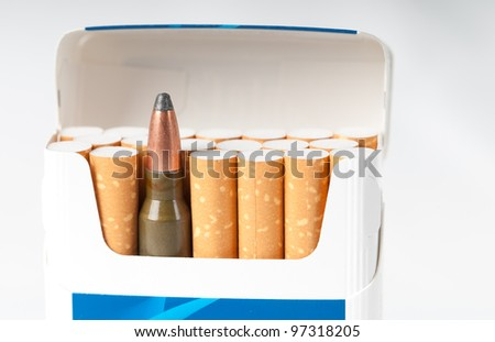 open pack of cigarettes with a weapon cartridge