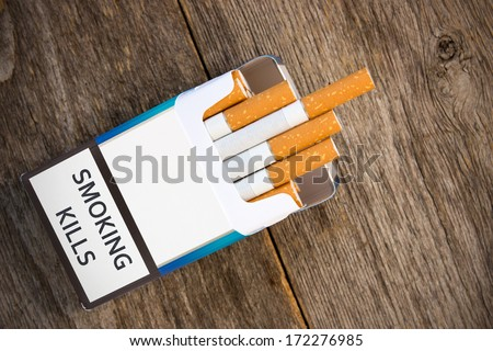 Open pack of cigarettes with the filter  - stock photo