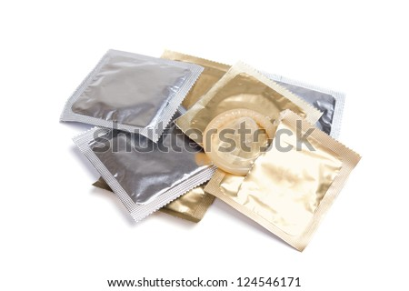 open pack of condom on a white background - stock photo