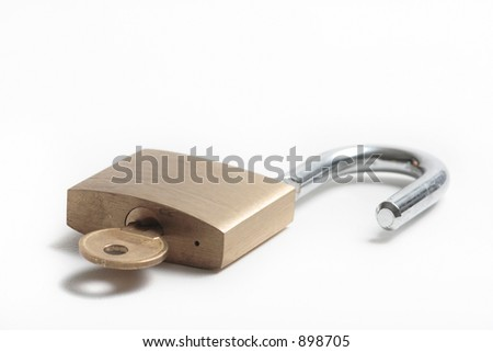 Open Padlock with key isolated on white