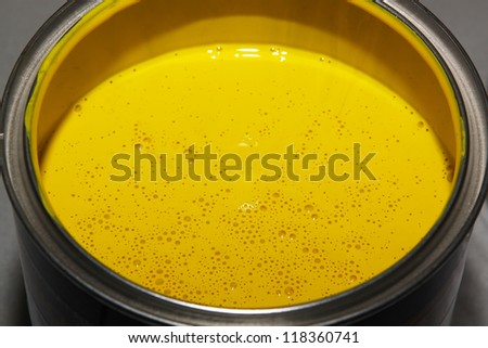 open paint can / bucket with vivid colors for home improvement - stock photo