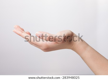 Open palm hand gesture of woman's hand. Isolated on white background. - stock photo