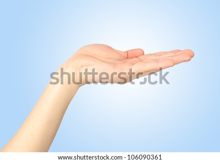 Open palm isolated on a blue background. - stock photo