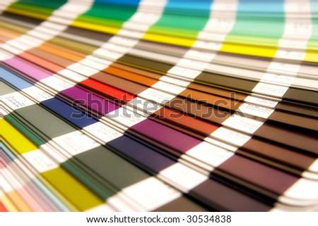 open Pantone sample colors catalogue - stock photo