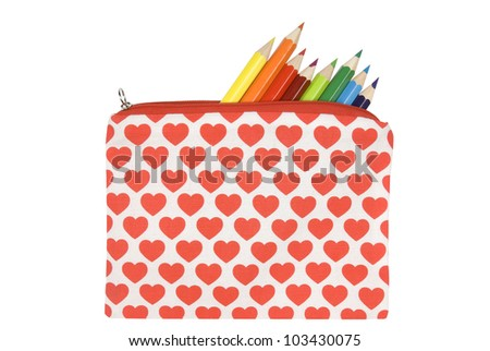 Open pencil case with heart pattern on a white background. Clipping path included. - stock photo