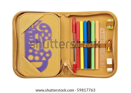 Open pencil case with various stationery - stock photo