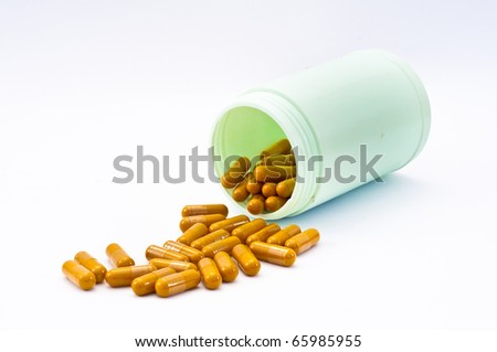 Open pill bottle with medicine spilling out of it isolated on white - stock photo