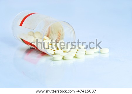 Open pills / drugs / painkillers container with reflection - stock photo