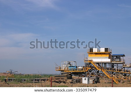 open pit coal mine with excavators and machinery - stock photo