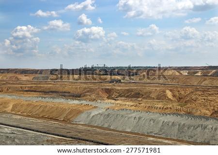 open pit coal mine with excavators  mining industry - stock photo