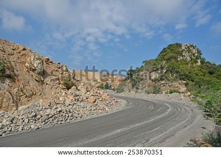 Open-pit limestone mining, Thailand. - stock photo