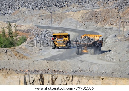 Open-pit mine with dump trucks. - stock photo