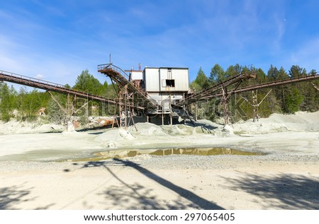 Open pit mining and processing plant for crushed stone, sand and gravel to be used in the roads and construction industry - stock photo