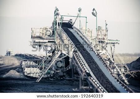 Open pit. Opencast brown coal mine. Belt conveyor as industrial detail. - stock photo