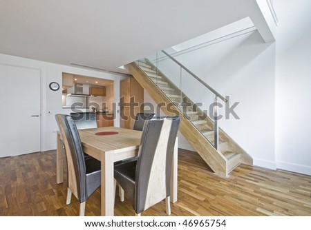 open plan dining room of a luxury duplex apartment - stock photo