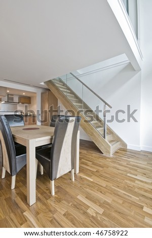 open plan living room in a duplex apartment - stock photo