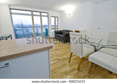 open plan living room with dining table and chairs