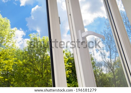 open plastic vinyl window on a background blue sky - stock photo