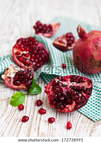 Open pomegranate with seed on wooden background