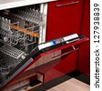 open pure empty dishwasher in kitchen furniture red - stock photo