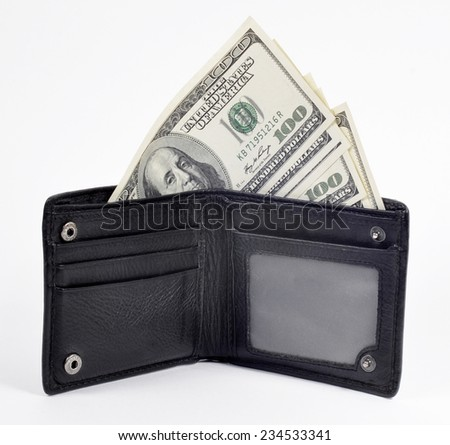 Open purse with dollars