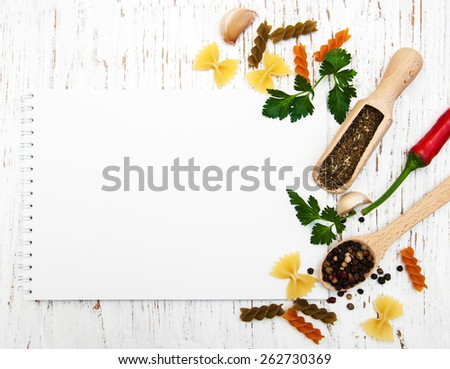 open recipe book with blank page with pasta and spices - stock photo