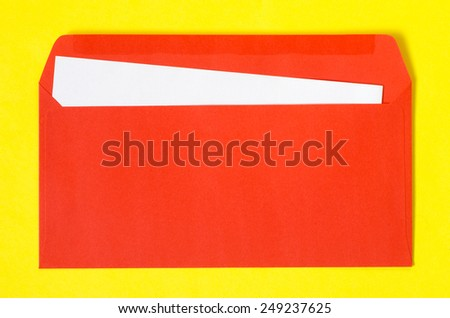 open red envelope with  blank paper on yellow  background - stock photo