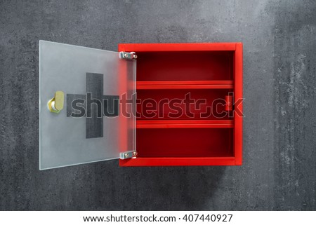 Open Red Metal Empty Medicine Cabinet Hanging On A Dark Gray Marble Wall  Background. Front