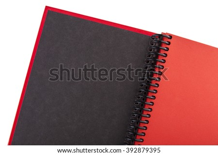 Open red paper notebook close up on the white background - stock photo
