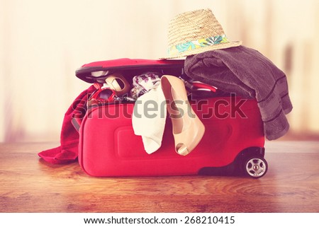 open red suitcase and floor with window  - stock photo