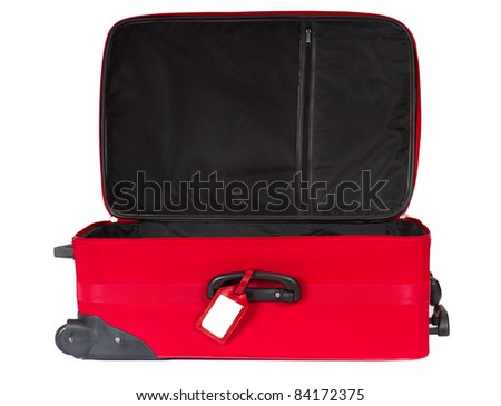 Open red suitcase with blank identification tag over white. - stock photo