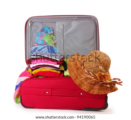 Open red suitcase with clothing isolated on a white - stock photo